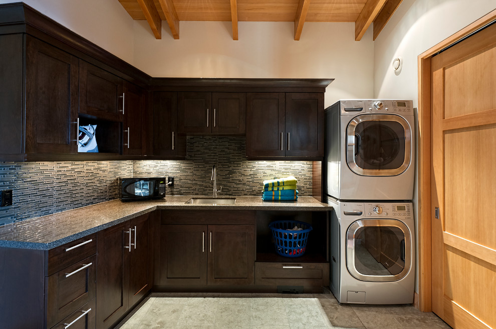 Modern And Luxurious Laundry Room Design With Black Cabinetry With Gray Backsplash With Natural Wooden Ceiling Idea With Washer And Dryer Closet Beyond
